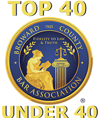 BCBA Top 40 Under 40 blue circle badge with lady liberty in gold